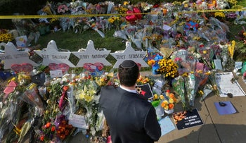 A man prays at a makeshift memorial outside the Tree of Life synagogue following a shooting at the synagogue in Pittsburgh, Pennsylvania.