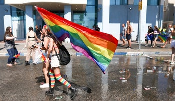 People take part in the annual LGBTQ pride parade in Tel Aviv, Israel, this month.