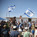 Jewish settlers in the illegal West Bank outpost of Evyatar, June 2021.
