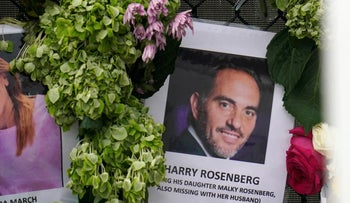 An image of Harry Rosenberg, hangs on a fence as part of a makeshift memorial in Surfside, Florida
