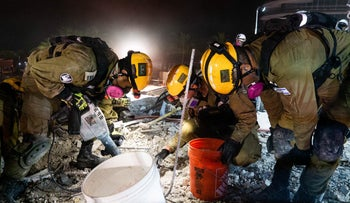 Israeli search-and-rescue forces at the site of the collapsed apartment building in Surfside, Fla.