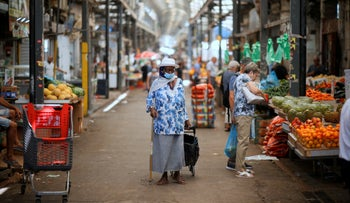 People shop at a market in the central Israeli city of Ramle.