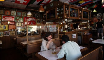 People sit in a restaurant in Istanbul, Thursday, July 2021.