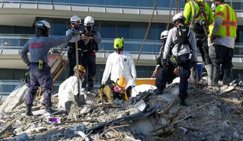 Search and rescue personnel work at the site of a collapsed Florida condominium complex in Surfside, Miami, yesterday.