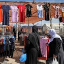 Women look at a clothing stall at an open-air market in the Bedouin town of Rahat in Israel's southern Negev region, earlier this month.