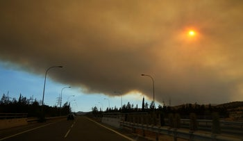 Smoke from a fire in the Larnaca mountain region fills the sky,  near the village of Mosfiloti, yesterday.