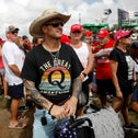 QAnon followers attend a rally by former President Donald Trump at the Sarasota Fairgrounds this weekend
