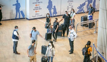 Passengers at Ben-Gurion International Airport's arrivals hall, late last month.