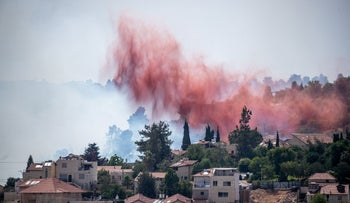 Flame retardants are used to put out a forest fire near Jerusalem, last month
