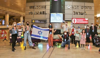A group of new immigrants after arriving at Ben-Gurion Airport last year.