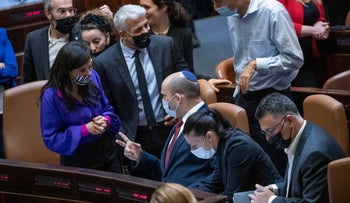 Interior Minister Shaked, Foreign Minister Lapid and Prime Minister Bennett in the Knesset chamber Tuesday.