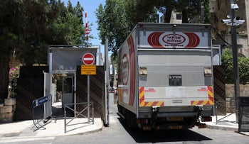 A moving van enters the prime minister's residence compound, on Jerusalem's Balfour Street, on Tuesday.