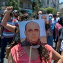 Angry demonstrators carrying pictures of Nizar Banat and chanting anti-PA slogans during a rally protesting his death, in Ramallah last month.
