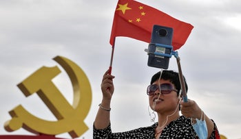 A woman taking a selfie at Tiananmen Square to mark the 100th anniversary of the founding of the ruling Chinese Communist Party in Beijing, earlier this month.