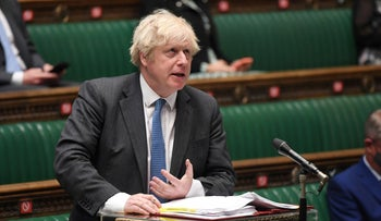 British Prime Minister Boris Johnson takes questions in Parliament, in London, last month.
