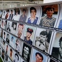 Banner with faces of Bosnian Muslims killed in the genocide outside the trial of ex-Bosnian Serb military commander Ratko Mladic at the International Criminal Court