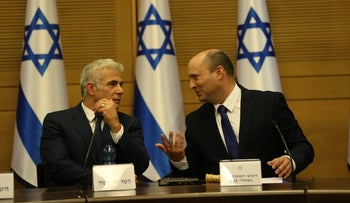 Foreign Minister Lapid, left, and Prime Minister Bennett at the Knesset in June.