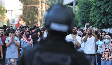 Palestinian security forces deploy as demonstrators rally in Ramallah city in the West Bank, last week.
