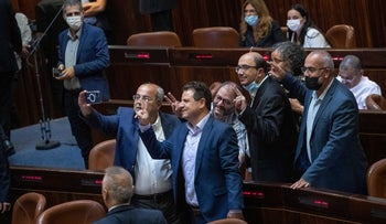 Members of the Joint List celebrating the opposition's victory in the Knesset on Tuesday.