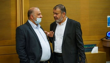 Mansour Abbas (L) and Walid Taha at the Knesset, April.