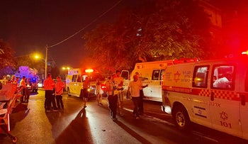 Emergency services at the murder scene in northern Bedouin village of Ibtin, Israel, on Saturday.
