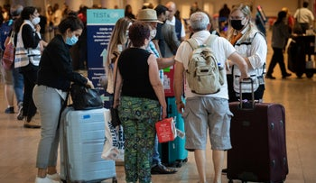 People queue to get tested for COVID in Ben-Gurion Airport, last month.