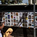Photos of the Meron disaster's victims near the sight of the incident, last month.