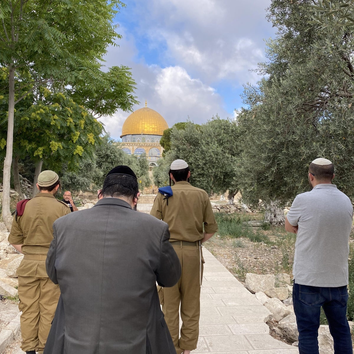Jewish worshippers, including several ultra-Orthodox men and off-duty soldiers, pray opposite the Dome of the Rock, the site of the Holy of Holies in the first and second Temples.