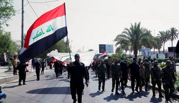 Iran-backed militia fighters march in central Baghdad, Iraq, June 29, 2021