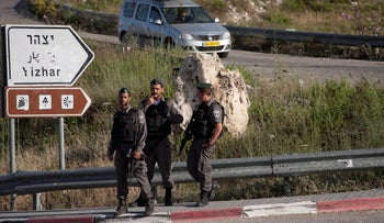 Border Police officers on the road leading to Yitzhar.