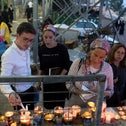 People pay respects to the victims of the Mount Meron disaster, in which 45 people were killed in a stampede in April, at the site in May.